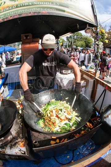 Man Uses Huge Wok To Make Stir Fry At Event