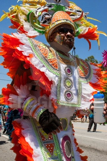 Man Wearing Colorful Costume Walks In Parade Celebrating Caribbe