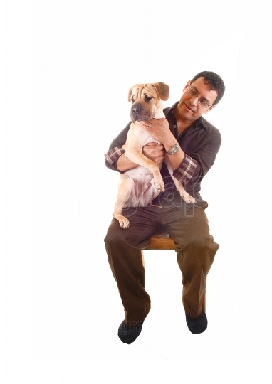 Man with dog on lap