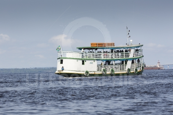 Manaus, brazil, october 17  typical wooden boats sailing on rio