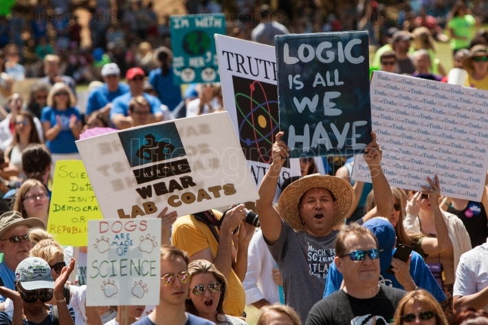 Marchers Display Signs At Rally Before Atlanta March For Science