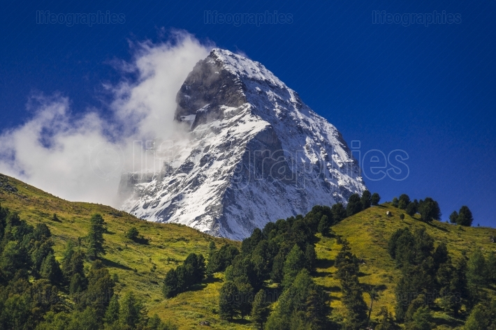 Matterhorn peak surrounded by green landscape