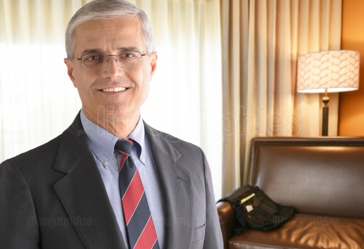 Mature Businessman in Hotel Room