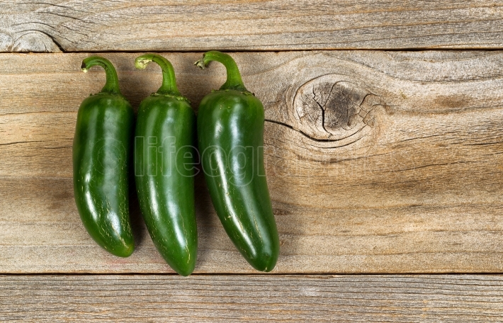 Mature hot peppers on rustic wood