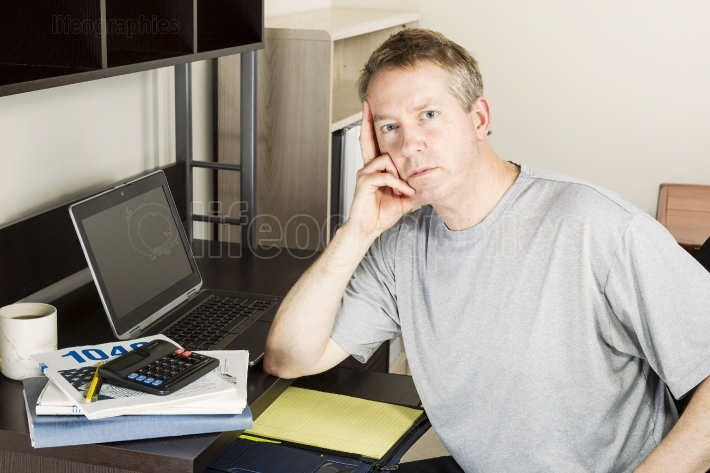 Mature man doing Personal Income Taxes