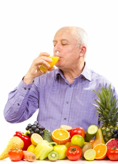 Mature man drinking orange juice