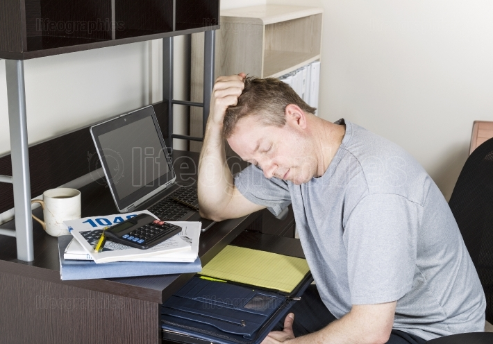 Mature Man getting Frustrated doing Personal Income Taxes