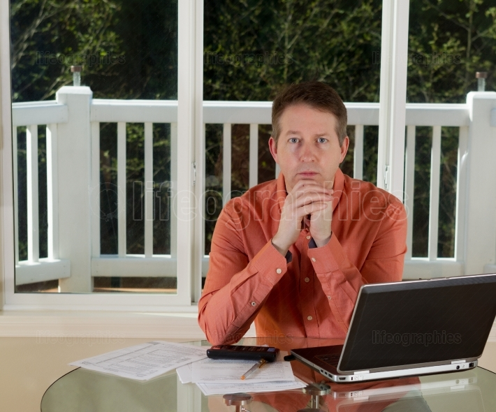 Mature man in Thought while working from home