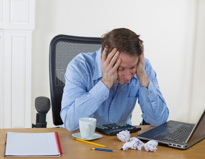 Mature man showing frustration while working