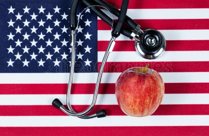Medical concept with apple and stethoscope on the United States
