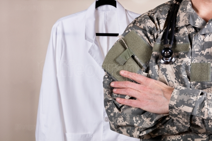 Medical military doctor with white consultation coat in backgrou