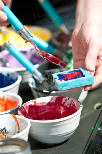 Melted Crayons Are Poured Into Mold For Art Project