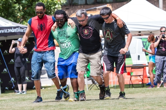 Men Move Together In Five-Legged Race