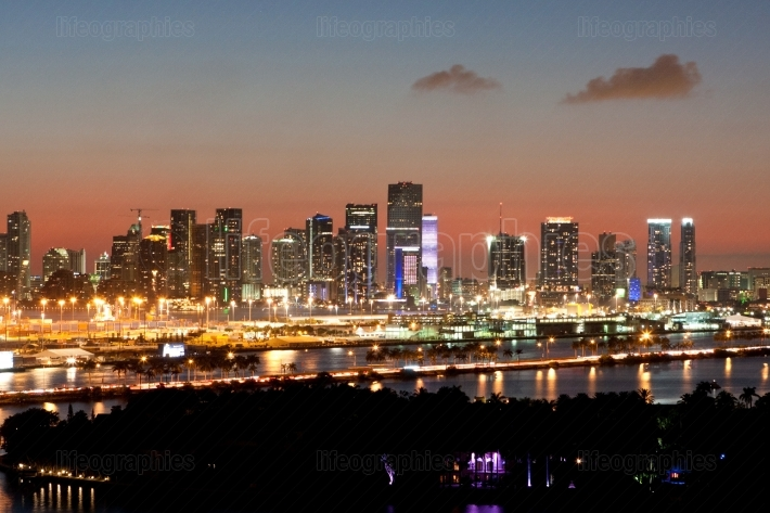Miami Skyline Lights Up At Dusk Against Pink Sunset