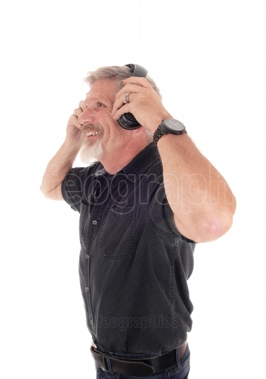 Middle age man having fun listening to music