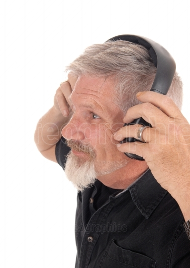 Middle age man listening to music
