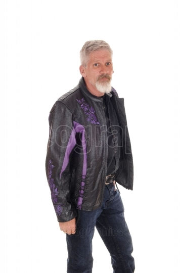 Middle age man standing with jacket