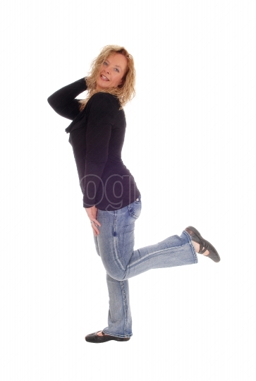 Middle age woman in jeans.