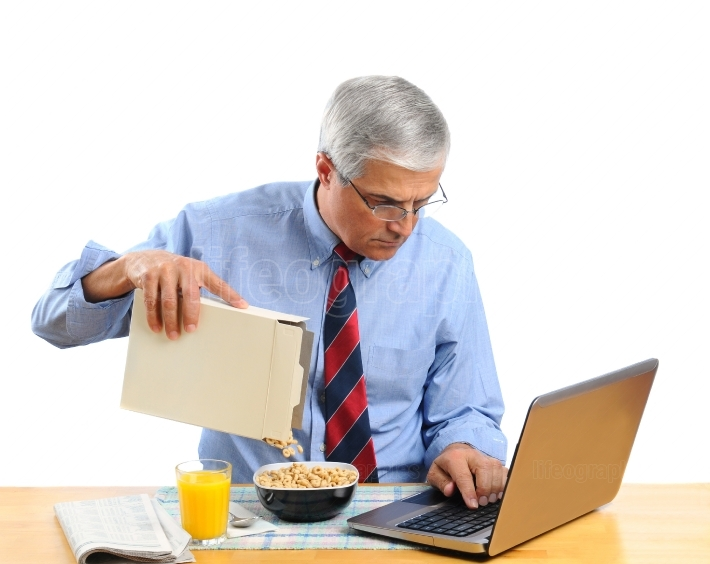 Middle Aged Man Pouring Cereal into a Bowl