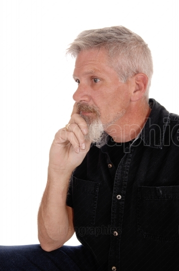 Middle aged man with hand on chin