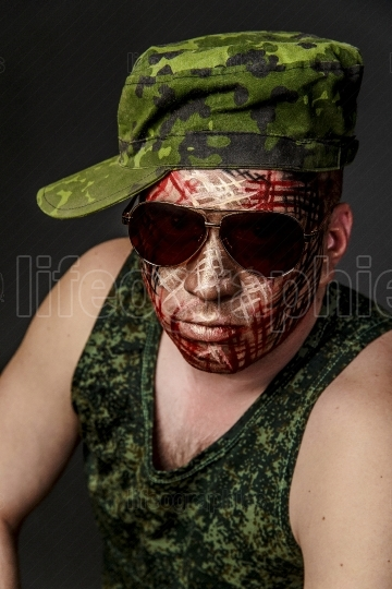 Military Style Camouflage on the Soldier s Face