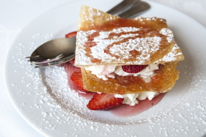 Millefeuille with strawberries and powdered sugar