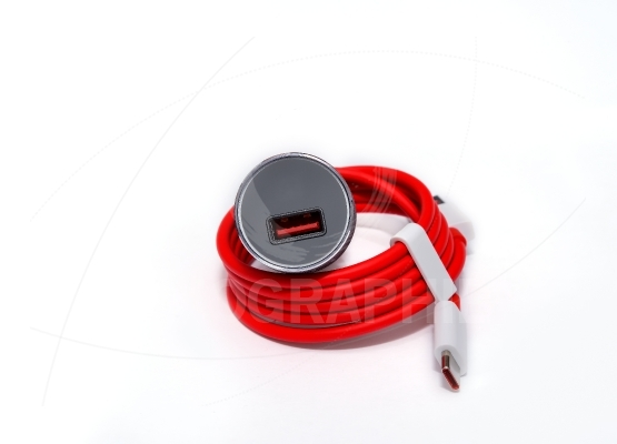 Mobile car charger and red usb cable isolated on white