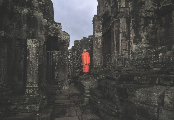 Monk in angkor wat cambodia. ta prohm khmer temple