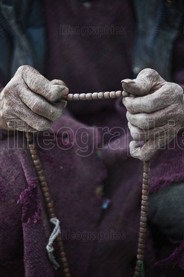 Monk with prayer beads