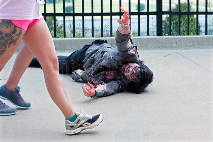 Monster Reaches For Women Passing By In Atlanta Zombie Run