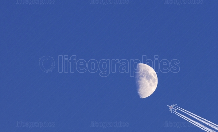 Moon and commercial airplane