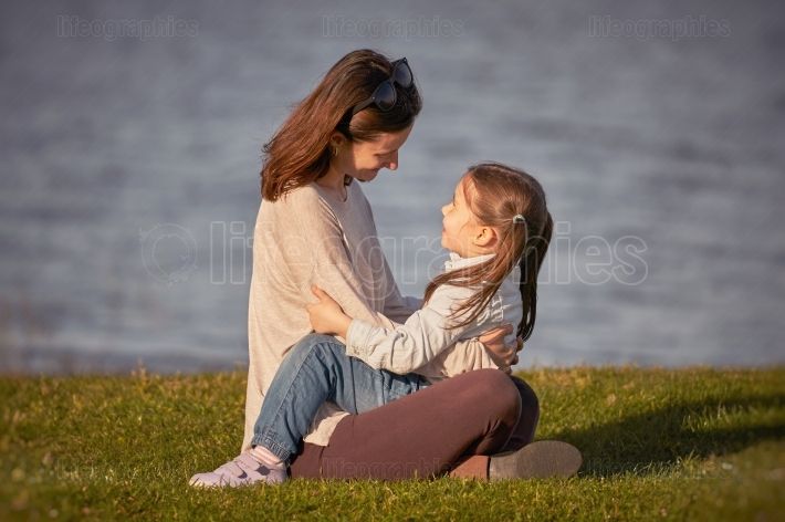 Mother and little girl enjoying time together outdoor