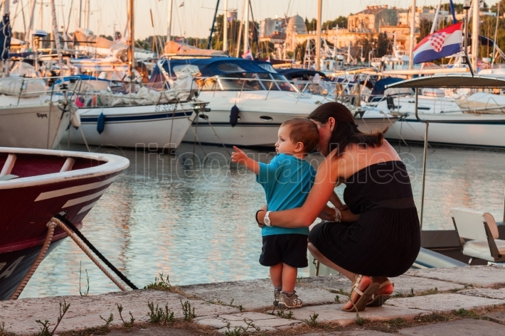 Mother and son in marina
