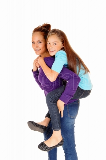 Mother piggyback daughter