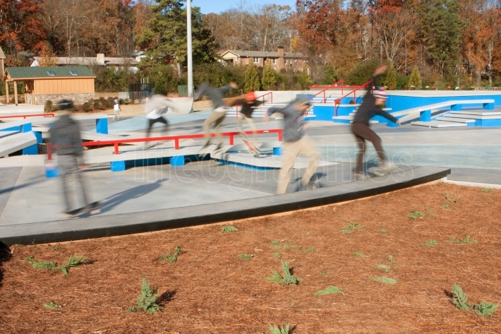 Motion Blur Composite Of Skateboarders Enjoying New Skateboard P