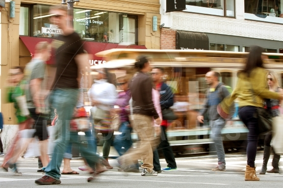 Motion Blur Of Pedestrians And Trolley Car In San Francisco