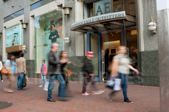 Motion Blur Of Shoppers Passing Storefront In San Francisco