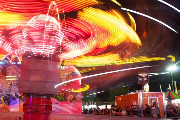 Motion blur of streaking lights from fast moving carnival ride