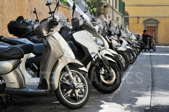 Motorbike, motorcycle scooters parked in row