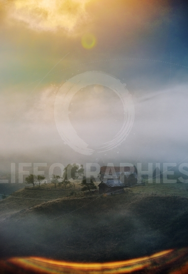Mountain landscape with autumn morning fog at sunrise