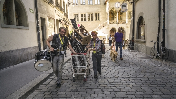 Musicians carrying musical instruments before beginning Buskers Festival