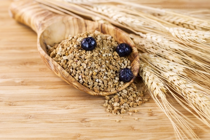 Natural Whole Grain Cereal in Wooden Spoon