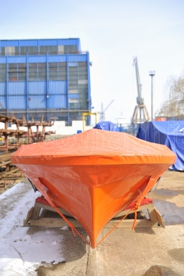 New lifeboat in shipyard storage place
