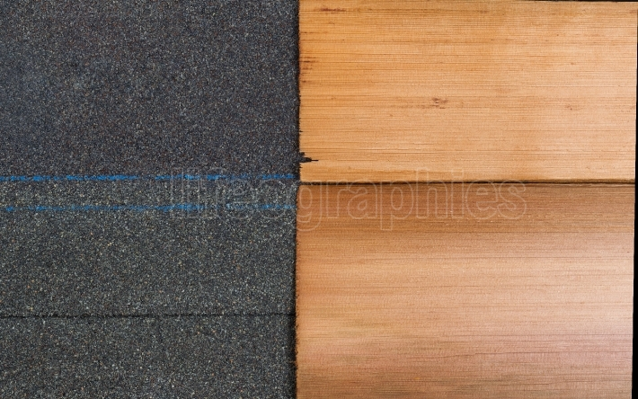 New shingles of composite and cedar wood side by side to compare