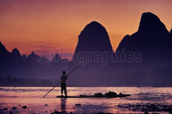 Night fisherman on the river Lijiang
