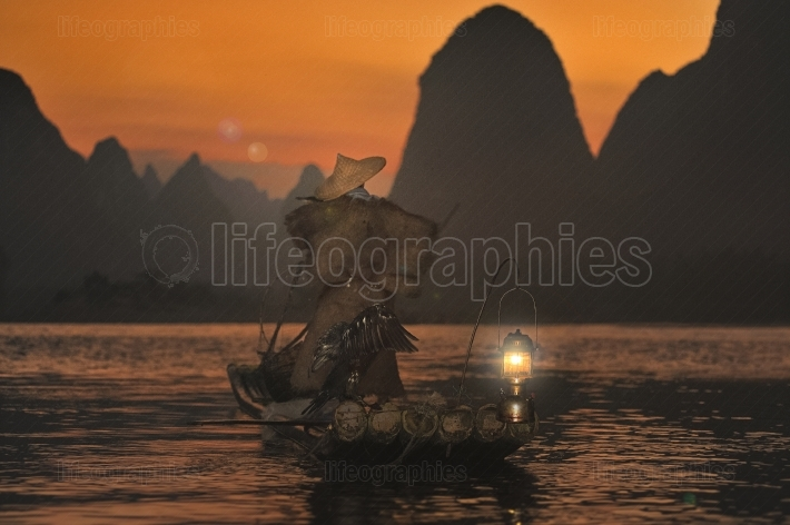 Night fishing with cormorants on the river lijiang