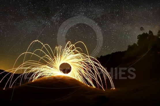 Night sky with milky way and fireworks