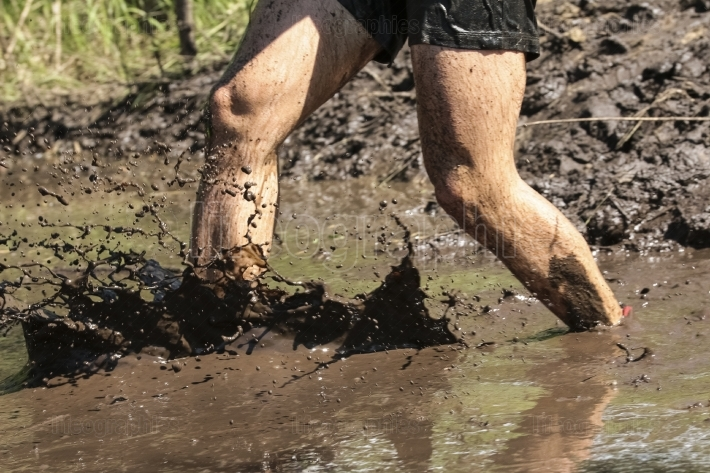 Obstacle race runner in action