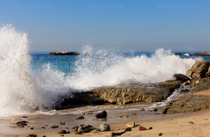 Ocean waves hitting rocks on Laguna Beach in California