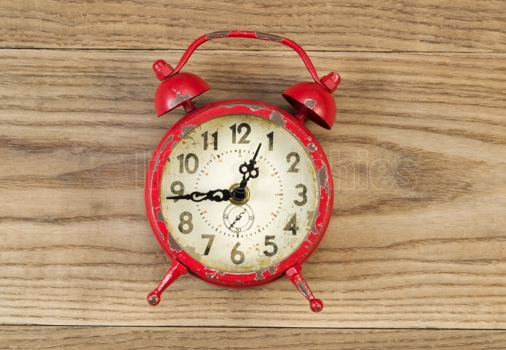 Old Alarm Clock on Rustic Wood